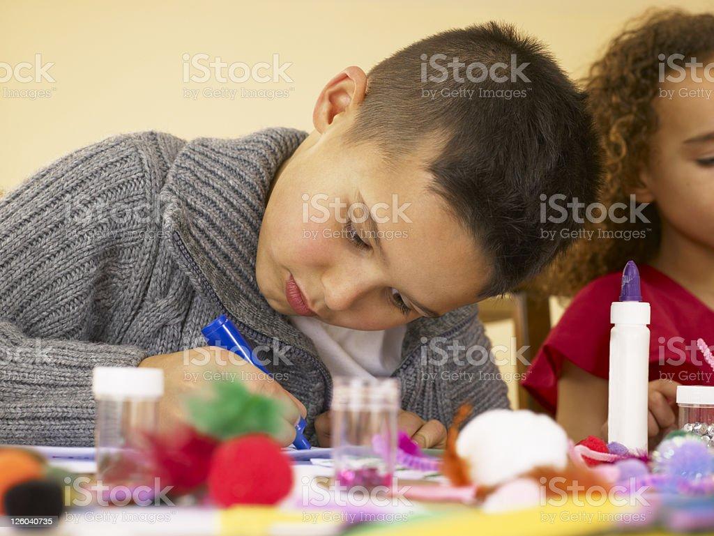 Young mixed race children doing handicrafts stock photo
