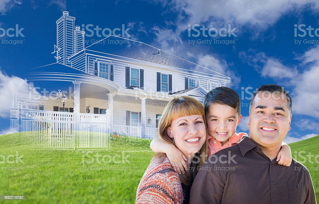 Young Mixed Race Family and Ghosted House Drawing on Grass stock photo