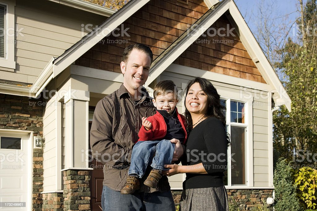 Young Mixed Race Family at Home stock photo