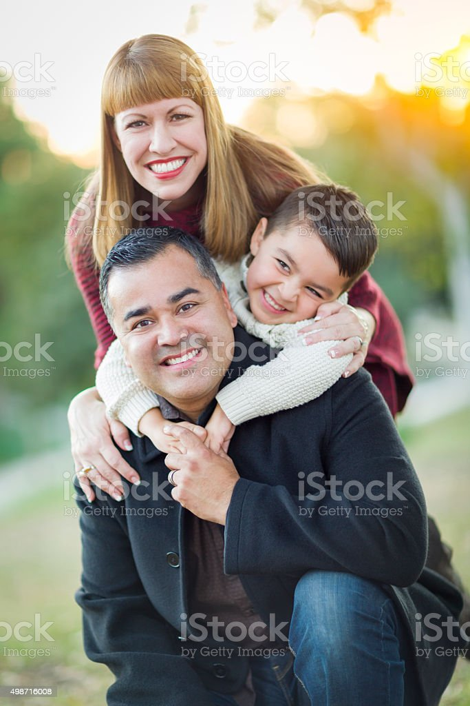 Young Mixed Race Family Portrait Outdoors stock photo