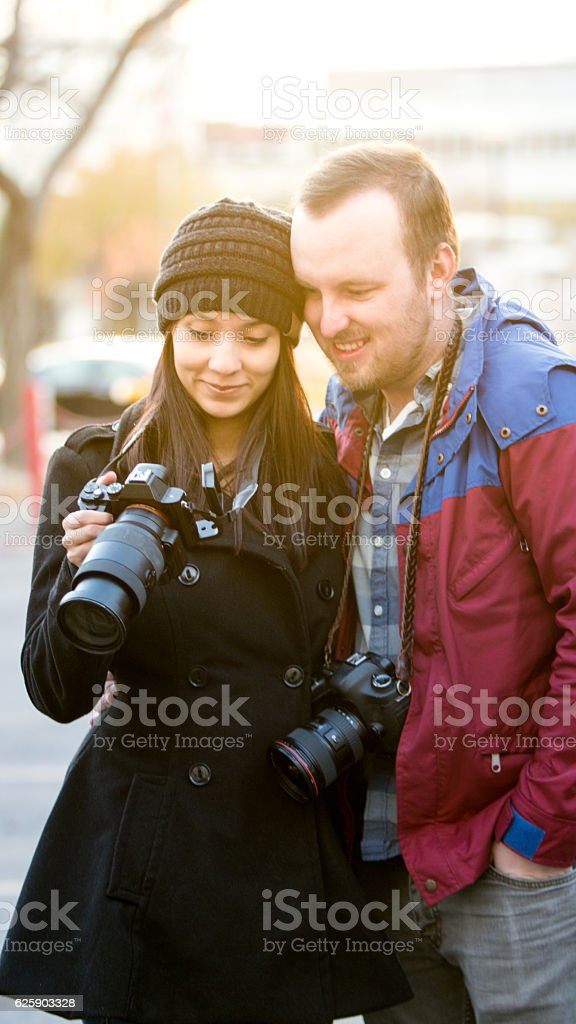 Young Mixed Race Traveling Couple Taking Photos stock photo