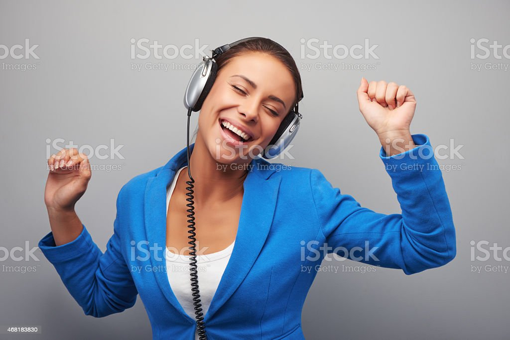 Young mixed race woman with headphones stock photo