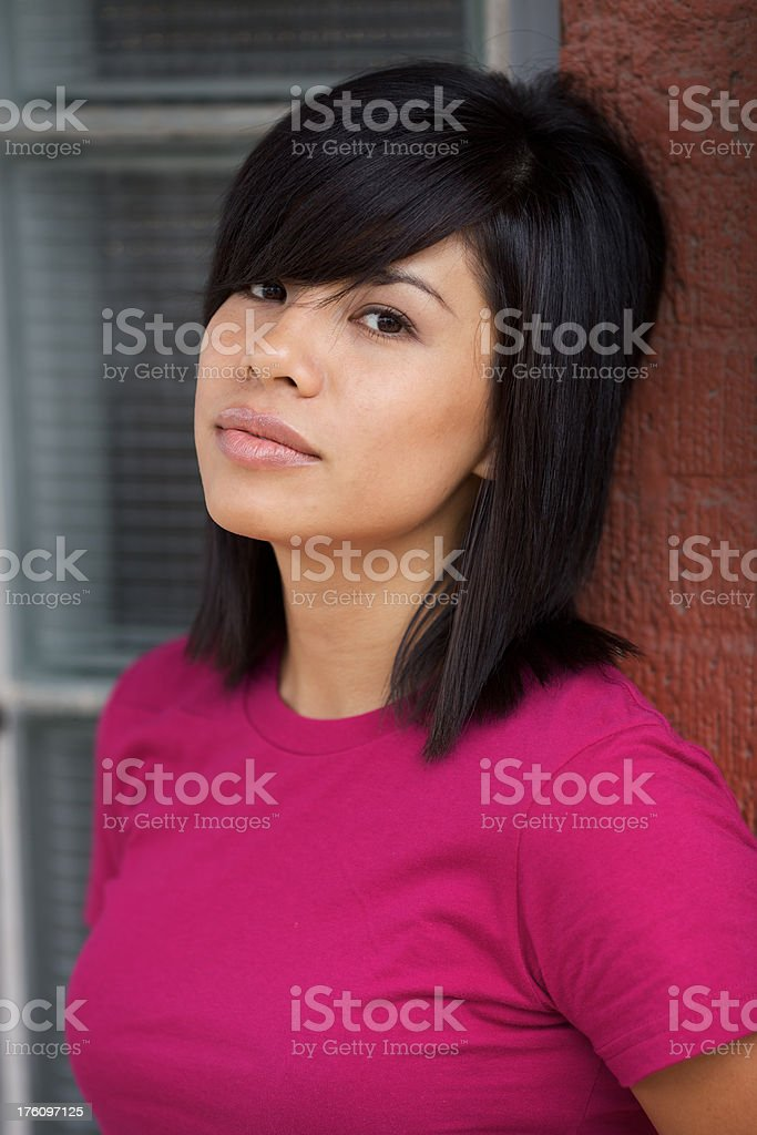 Young model against glass brick wall royalty-free stock photo