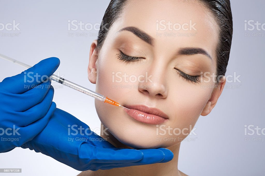Young model having plastic operation stock photo