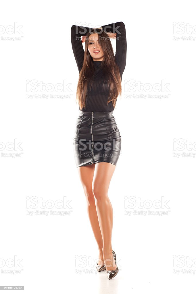 young model in short leatjer skirt stock photo