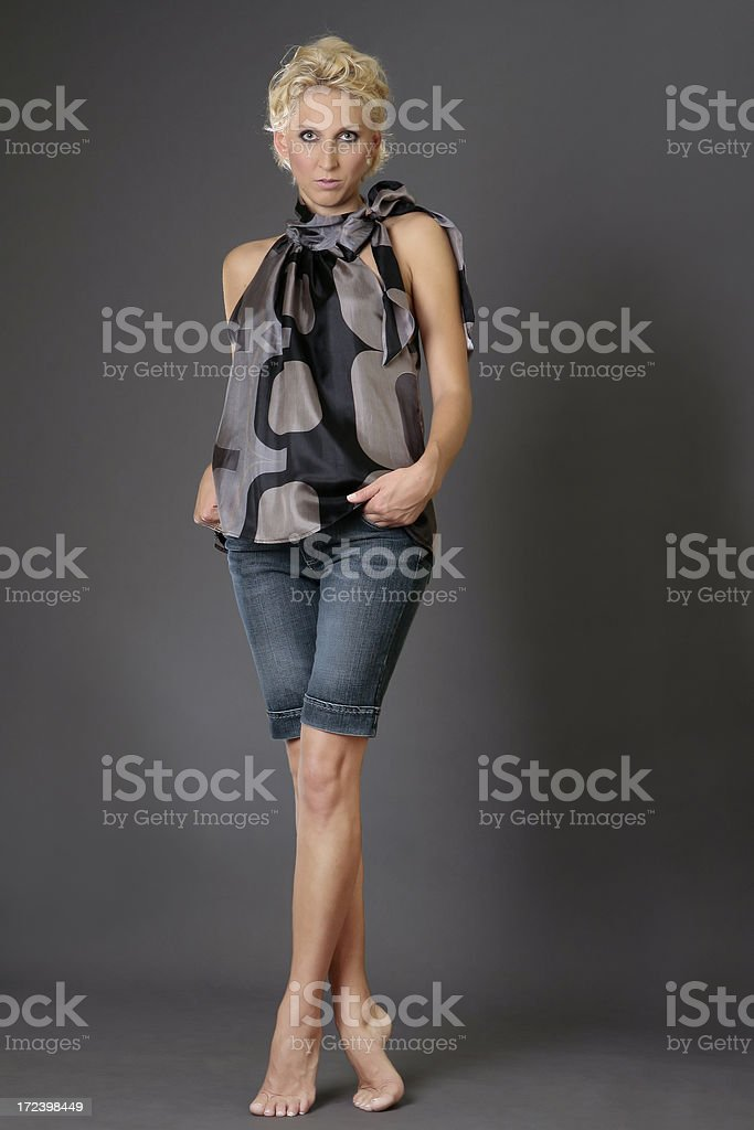 young model standing in bright light royalty-free stock photo
