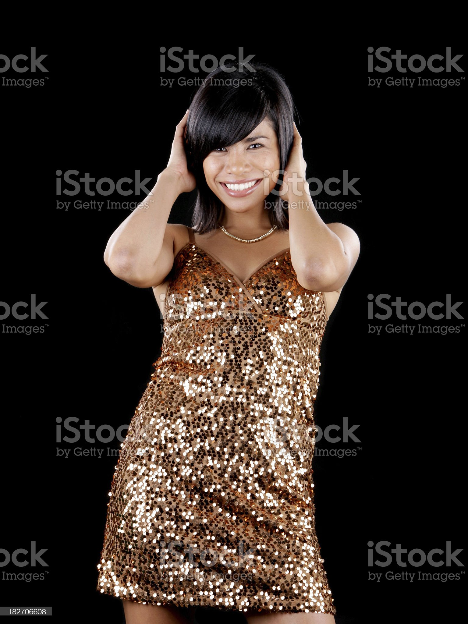 Young model with gold cocktail dress royalty-free stock photo