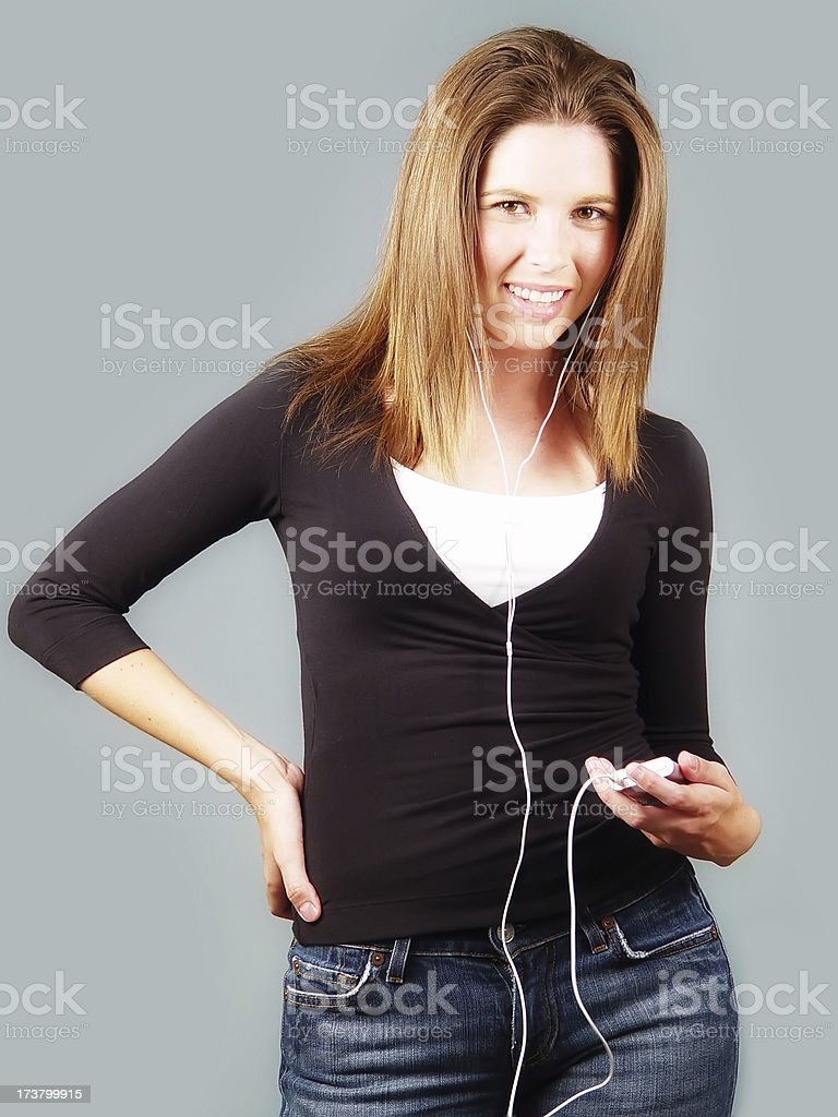 Young Model with Portable Audio Player royalty-free stock photo