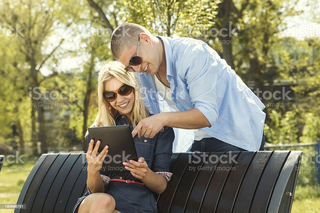 Young modern couple using digital tablet royalty-free stock photo