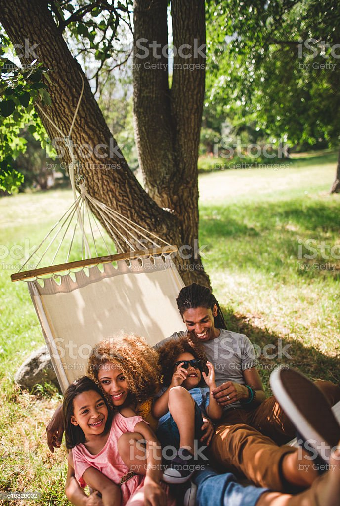 Young modern family enjoying lazy family day in the sun. stock photo