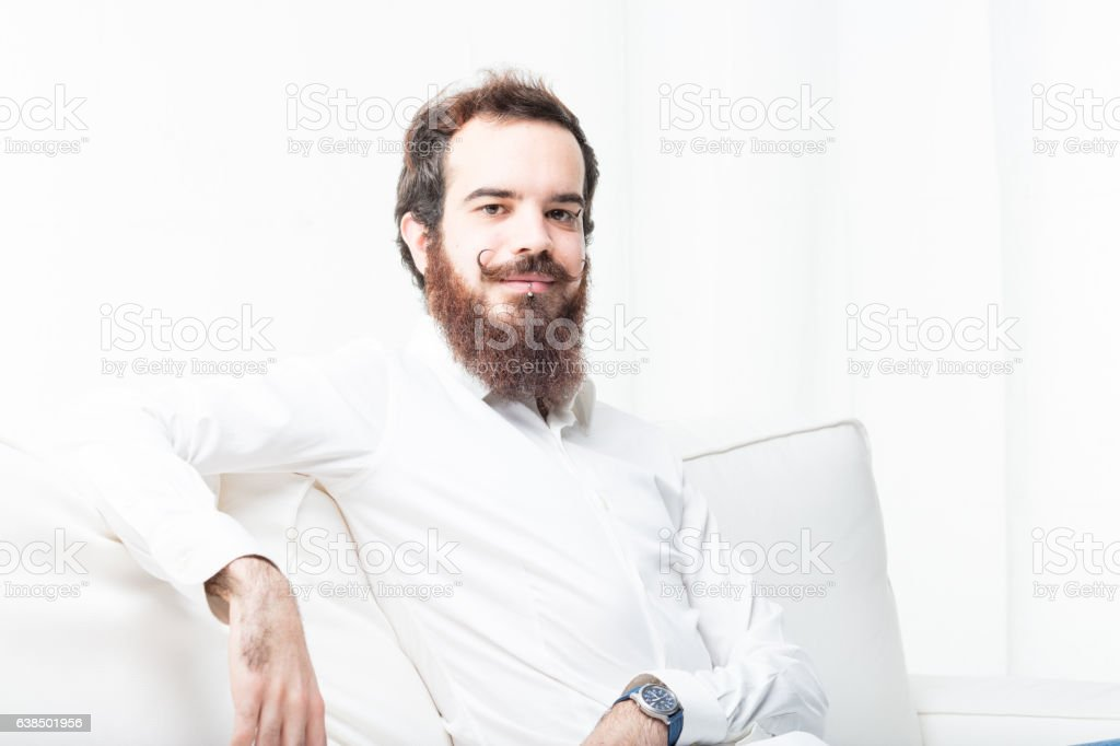 young modern man on his couch stock photo