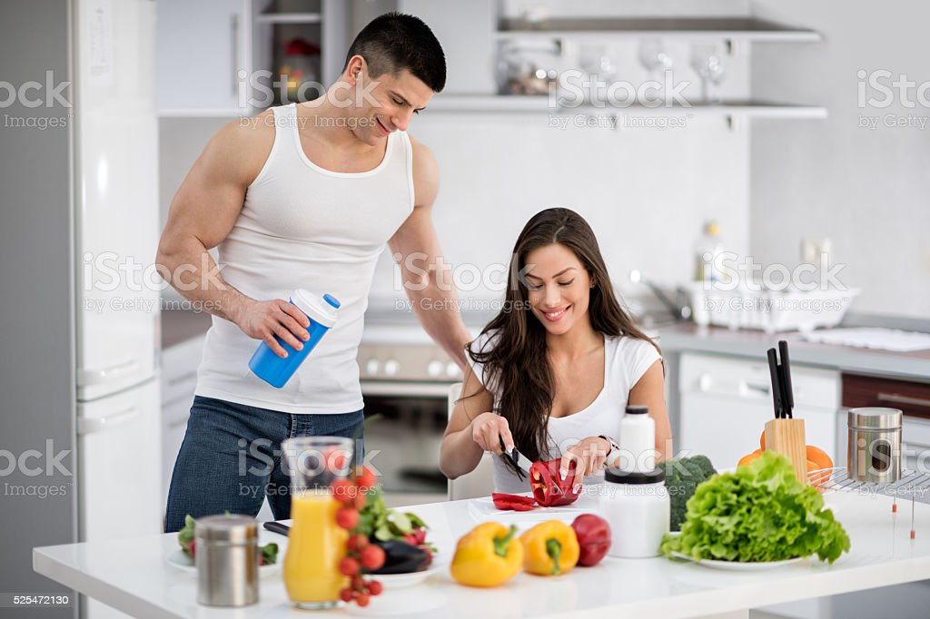 Young modern people in the kitchen stock photo
