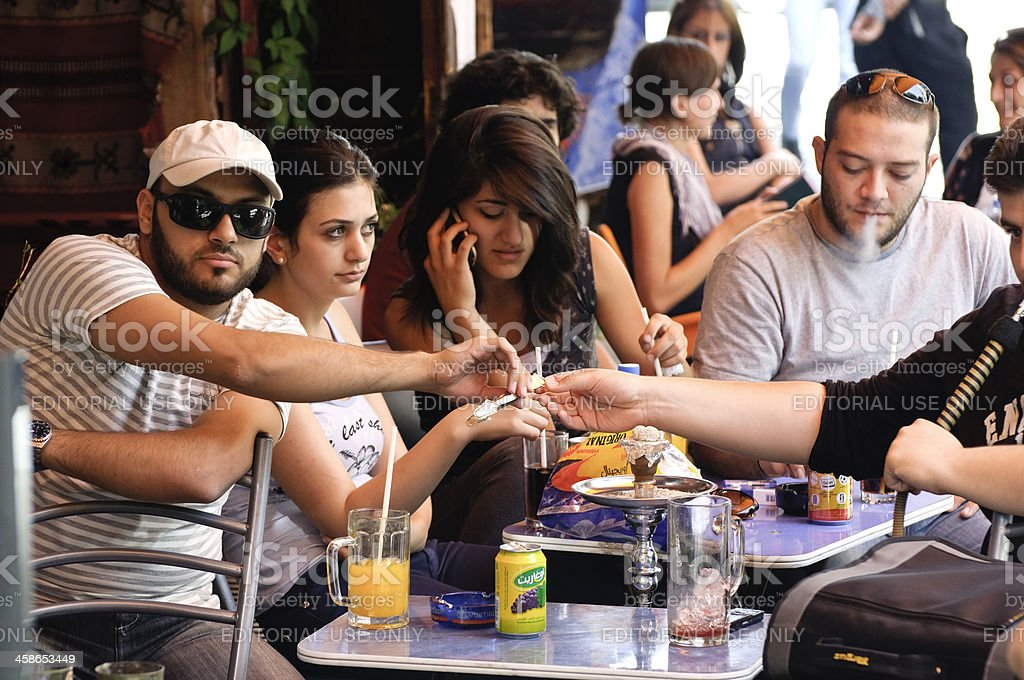 Young modern Syrians at a cafe in Damascus, Syria royalty-free stock photo