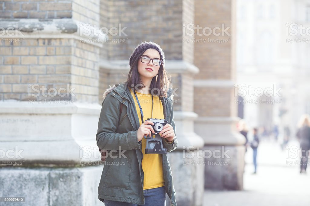 Young modern woman takeing look at architecture on veacation. stock photo