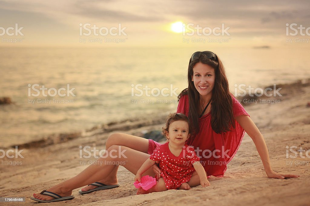 young mom and her baby girl on the beach royalty-free stock photo