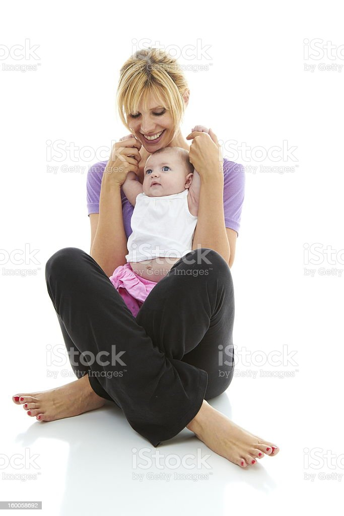 young mom holding her bundle of joy stock photo