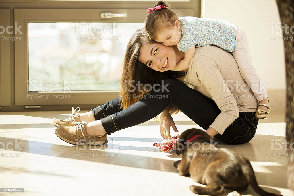 Young mom with her babies stock photo