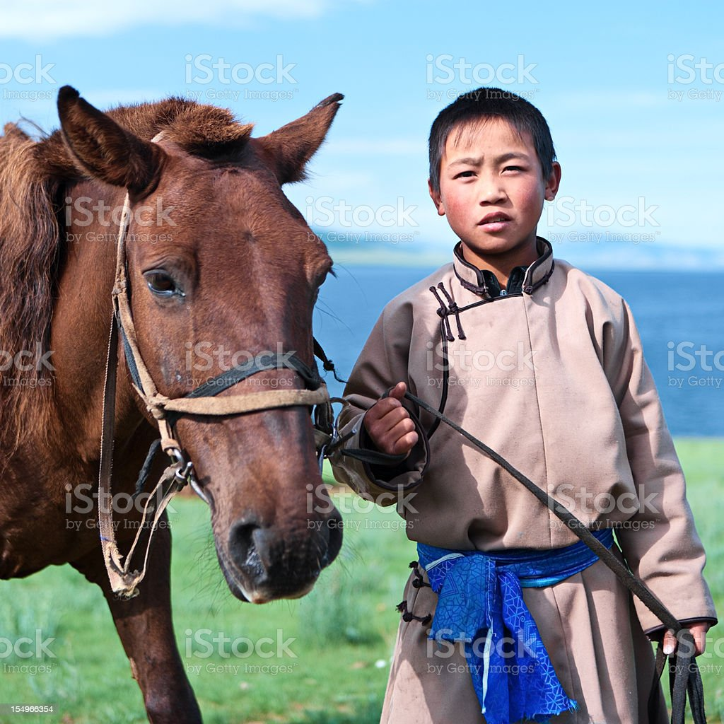 Young Mongolian horseback rider royalty-free stock photo