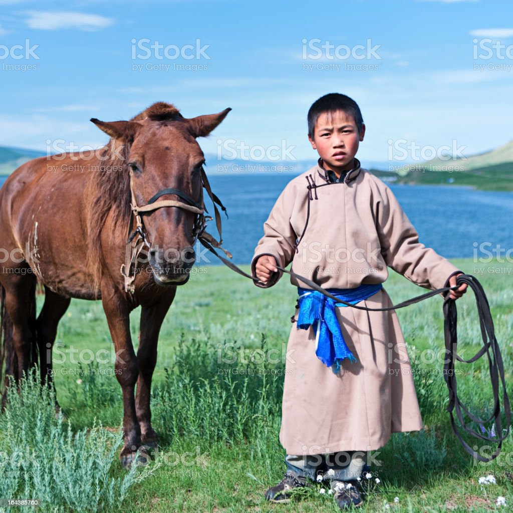 Young Mongolian horseback rider stock photo