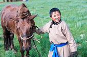 Young Mongolian horseback rider