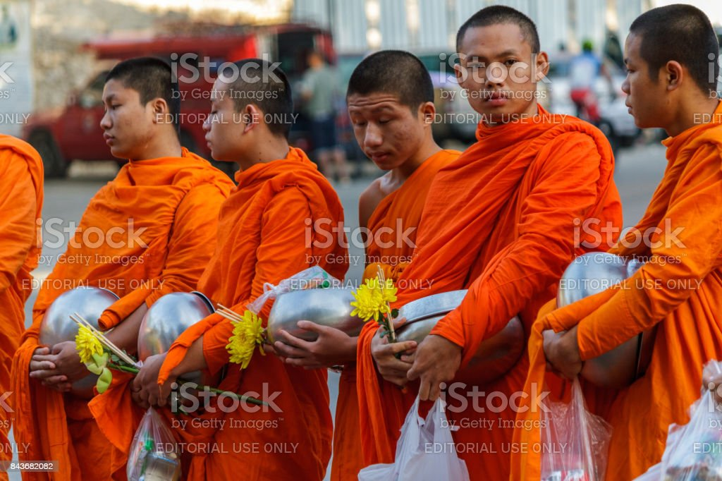 Young monks collect donations in Chiang Mai, Thailand stock photo
