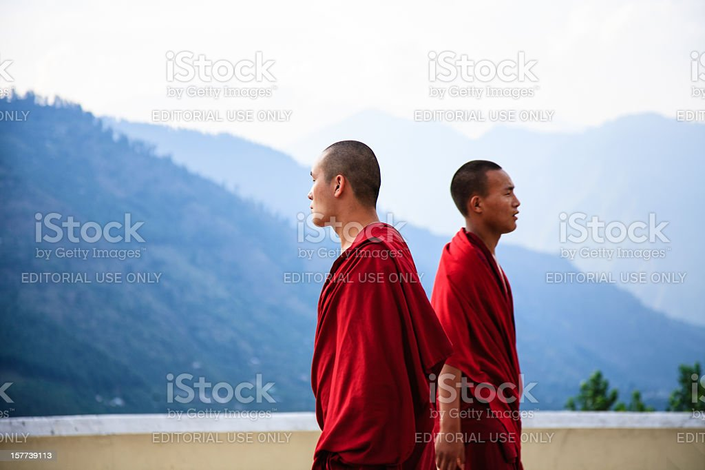 Young monks facing opposite directions stock photo