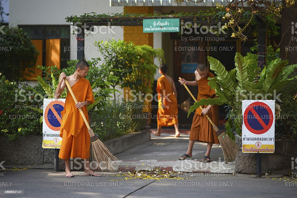 Young Monks Sweep The Floor stock photo