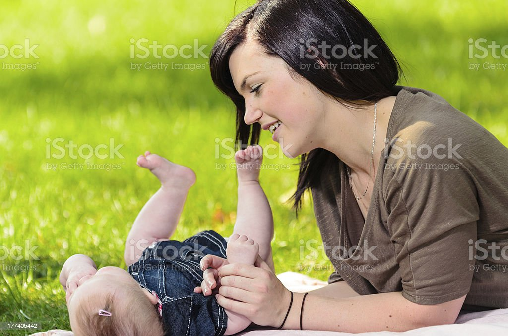 Young mother and baby in a park stock photo