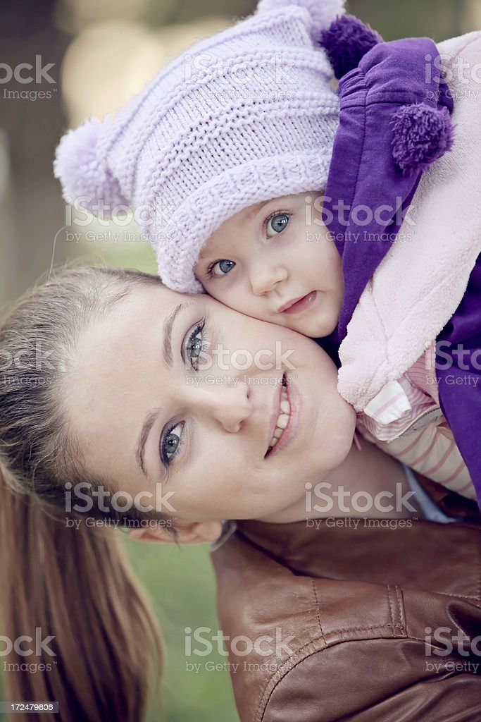 Young mother and beautiful daughter cuddling royalty-free stock photo