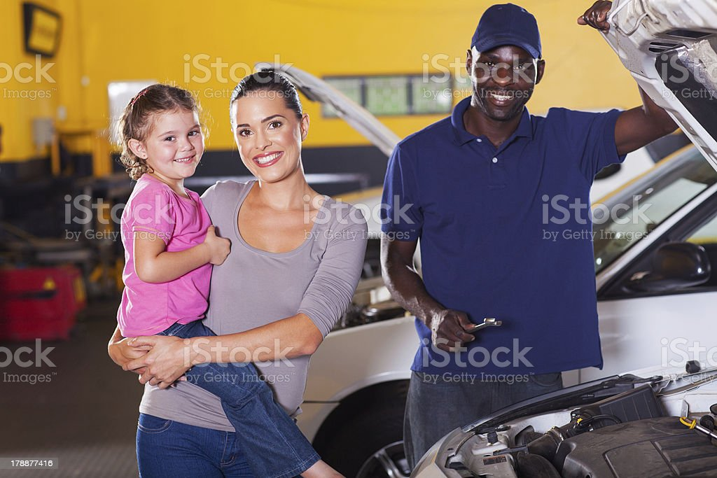 young mother and daughter in garage royalty-free stock photo