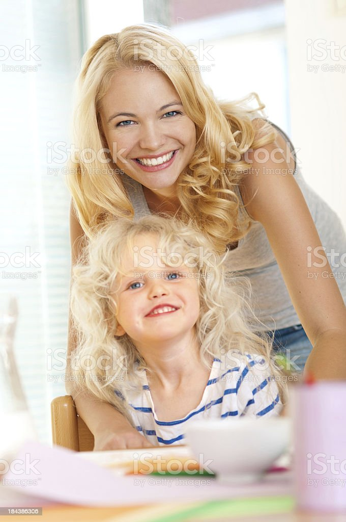 young mother and daughter smiling together royalty-free stock photo
