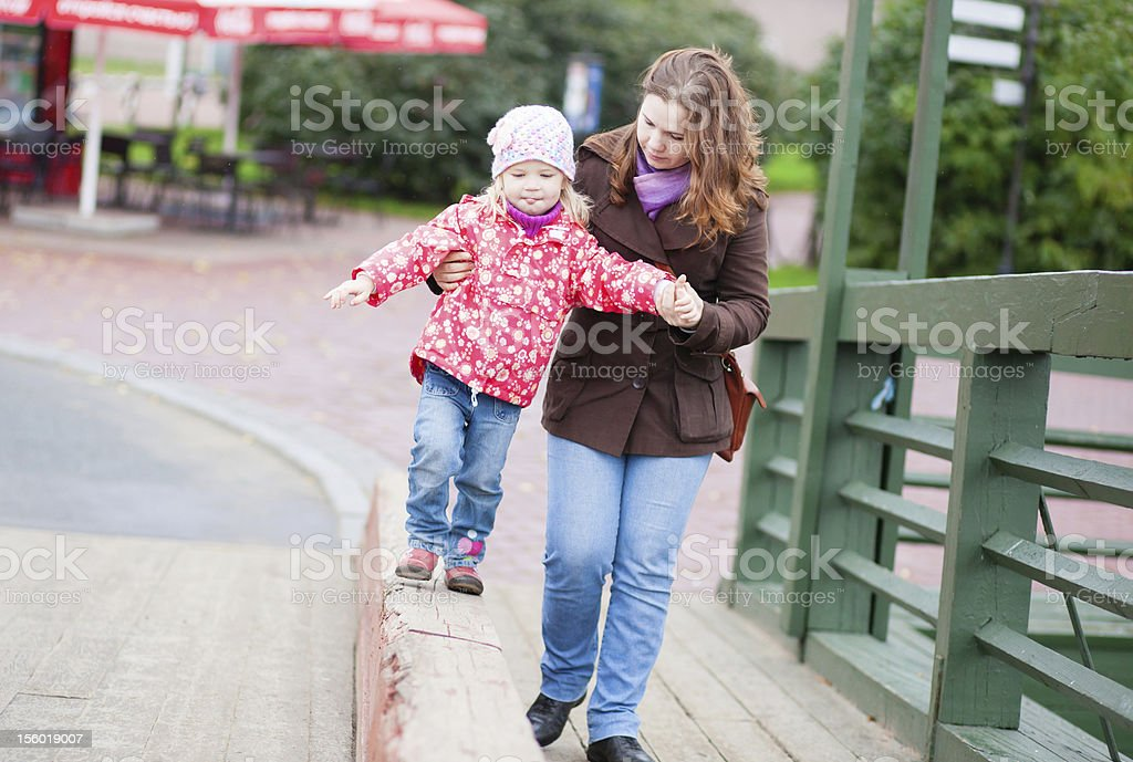 Young mother and daughter walking together royalty-free stock photo