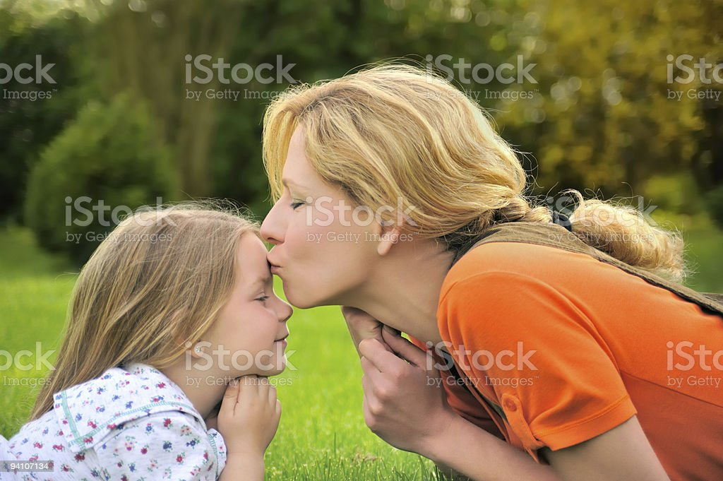 Young mother and dauhter - kiss royalty-free stock photo
