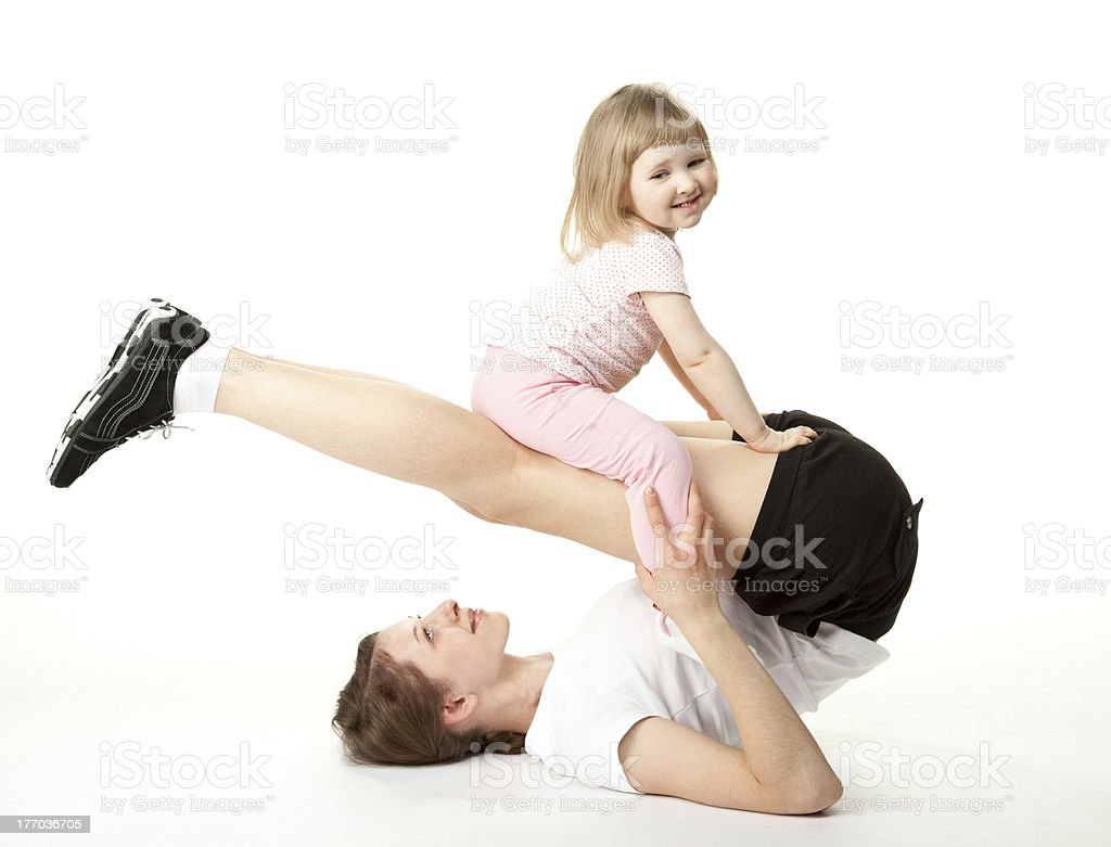 Young mother and her little daughter doing sport exercises royalty-free stock photo
