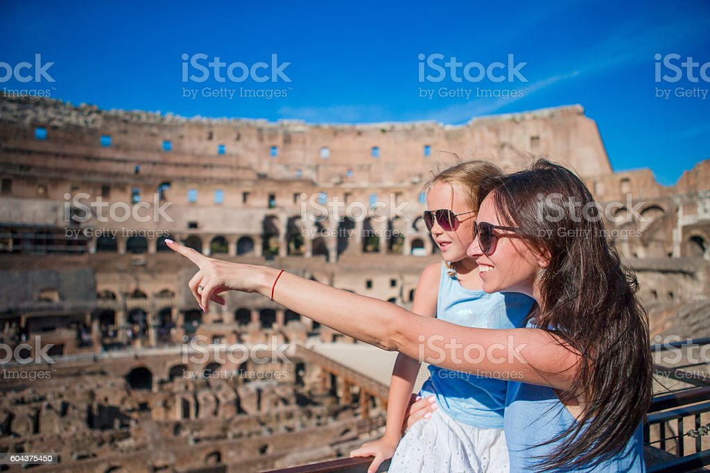 Young mother and little girl hugging in Coliseum, Rome, Italy. stock photo
