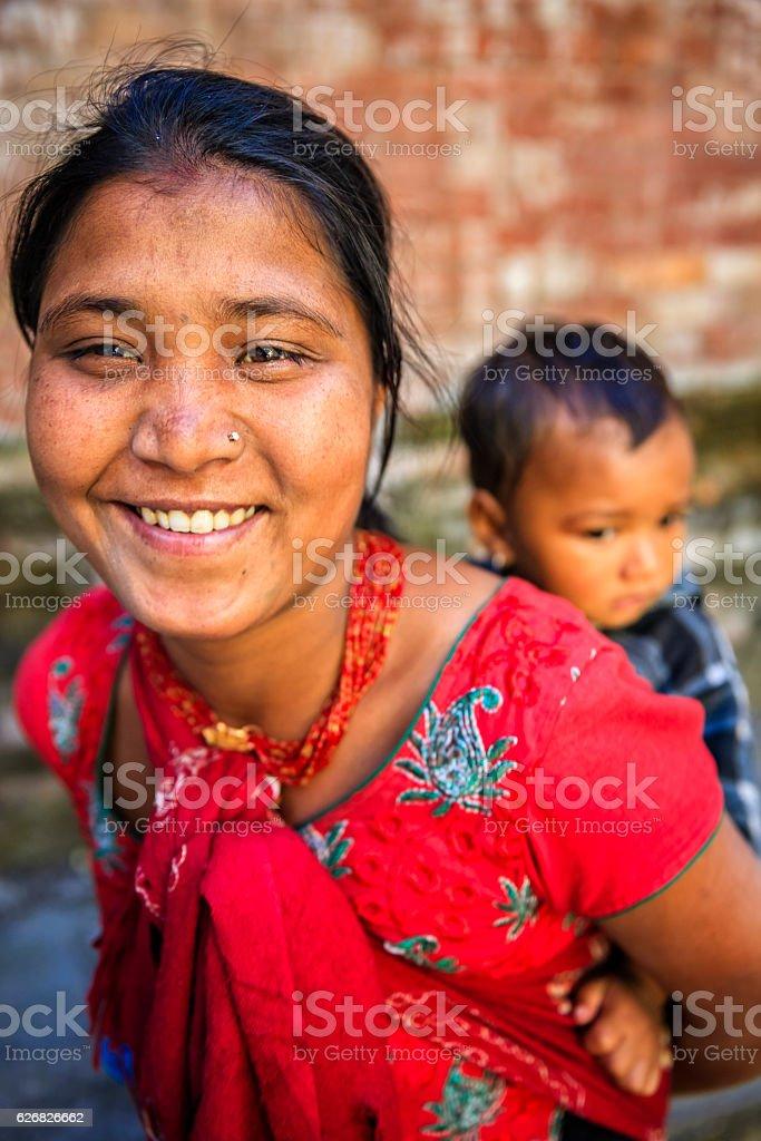 Young mother carrying her baby, Kathmandu, Nepal stock photo