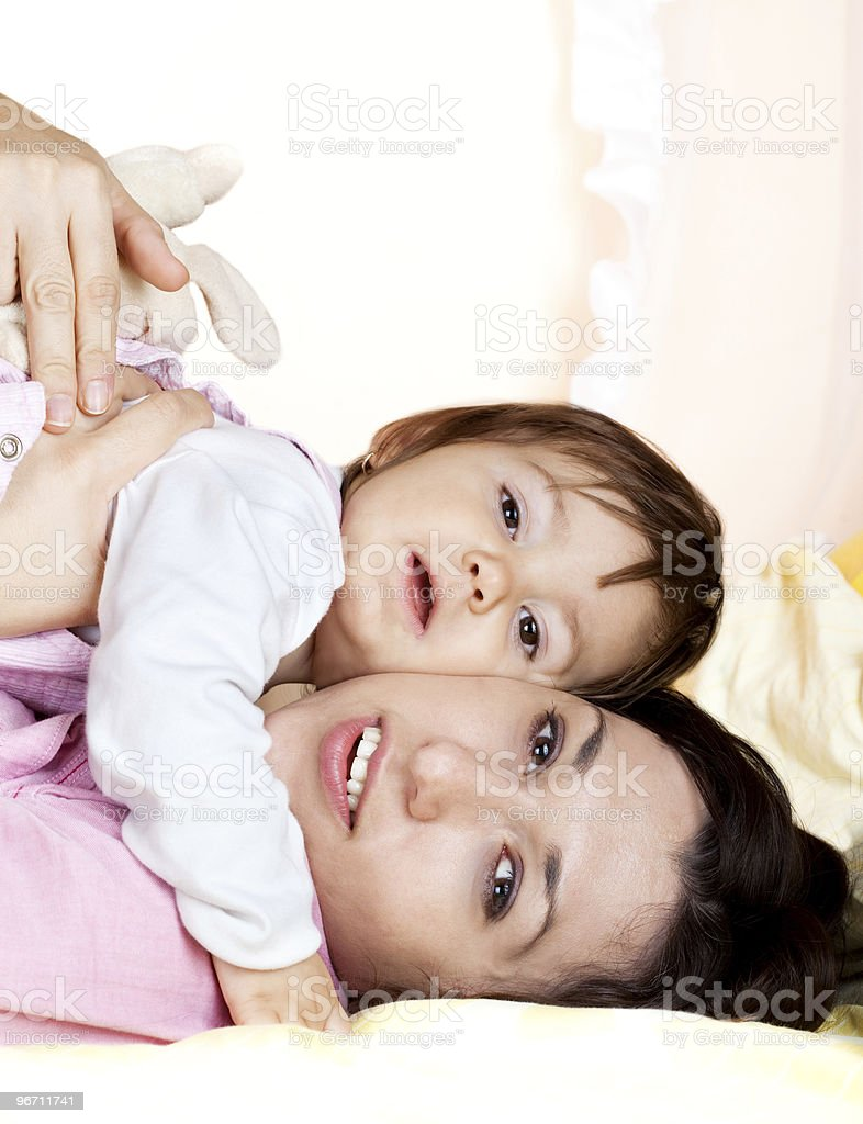 Young mother holding cute baby stock photo