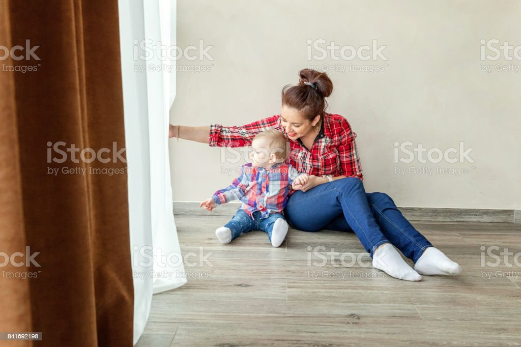 Young mother holding her child stock photo