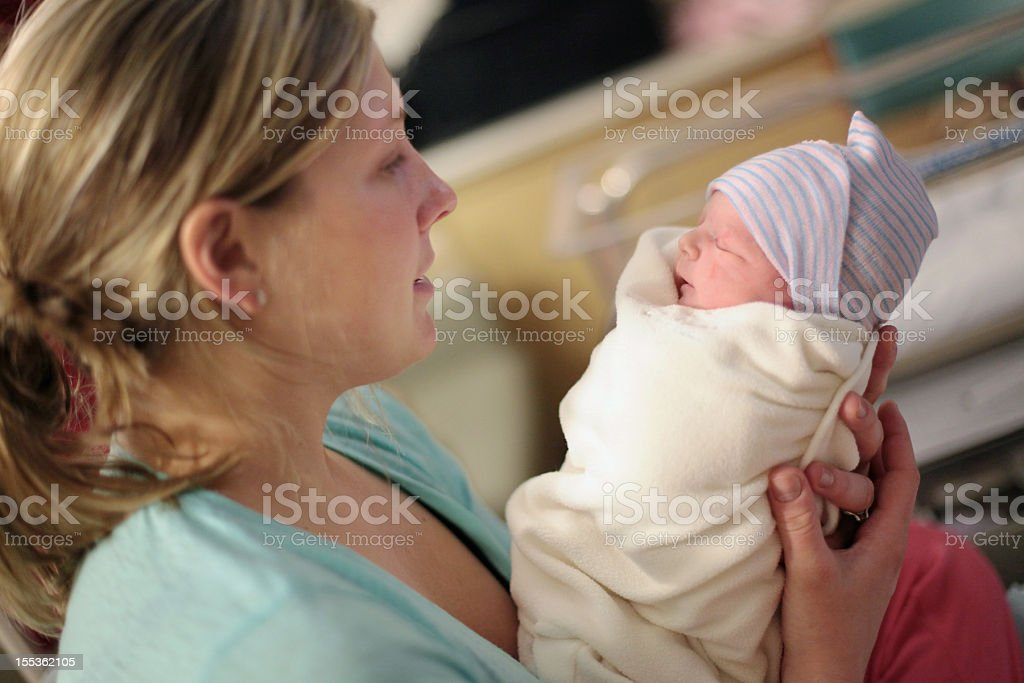 Young Mother Holding Newborn stock photo