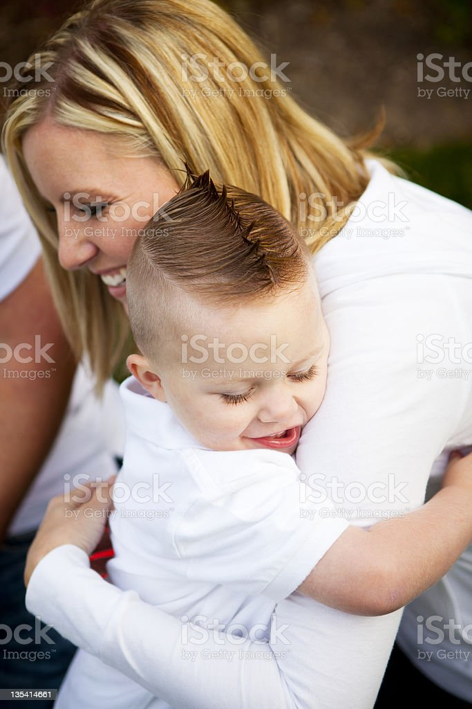 Young Mother Hugging Her Son stock photo