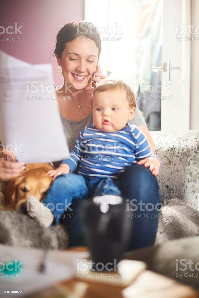 young mother on the phone to her insurance company stock photo