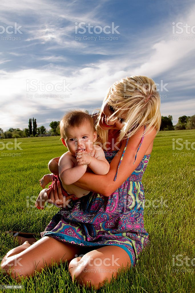 Young Mother Outside with Baby royalty-free stock photo