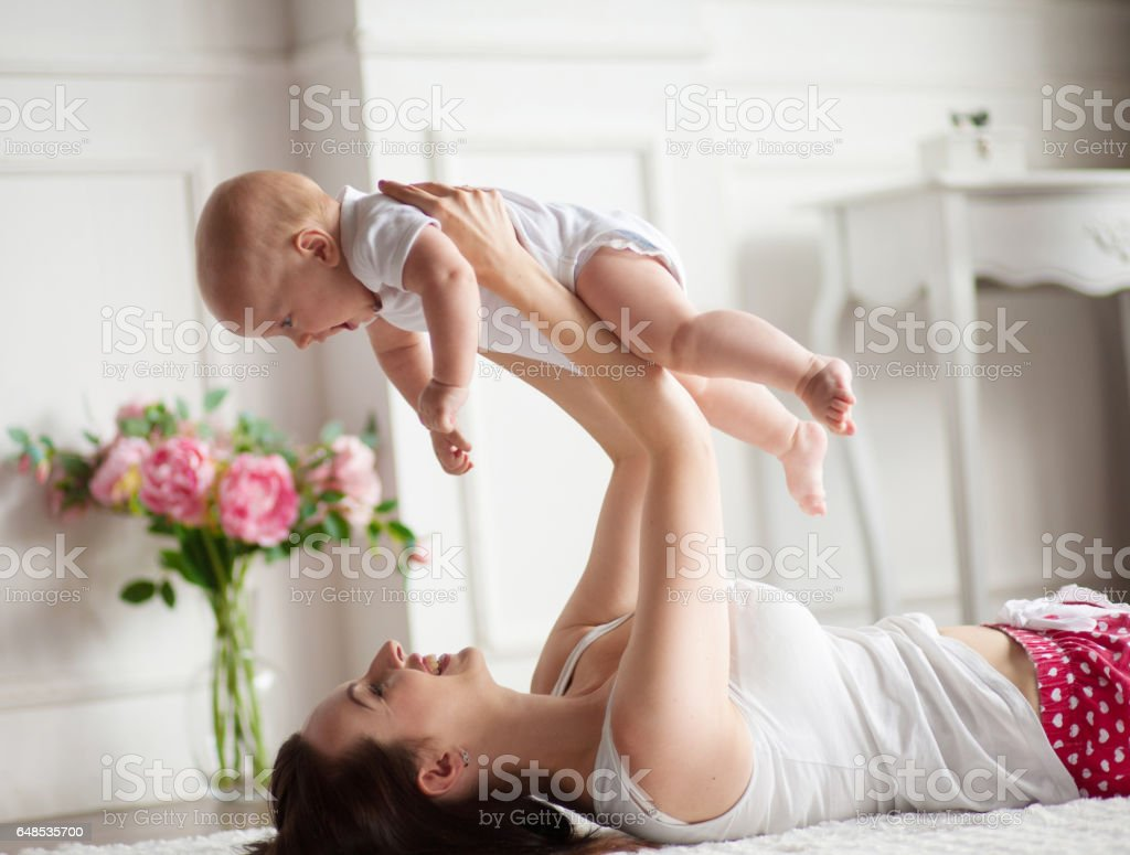 Young mother playing with her baby. stock photo