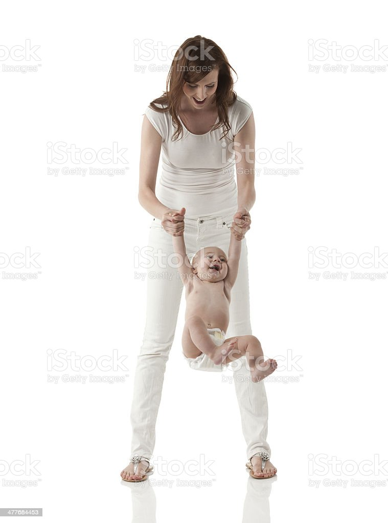 Young mother playing with her child royalty-free stock photo