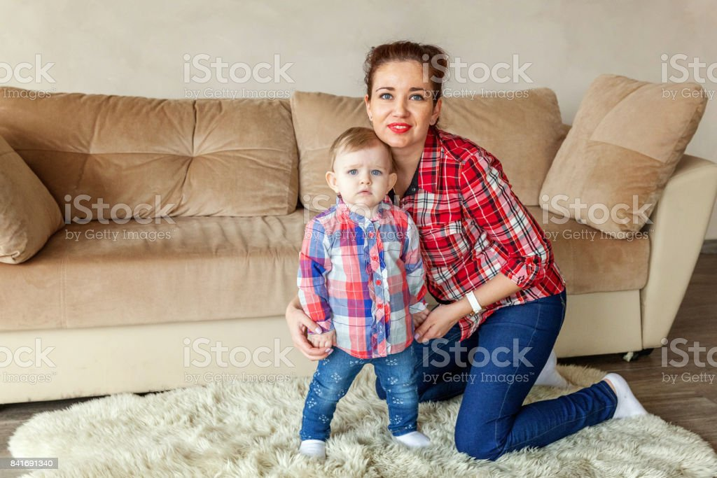 Young mother playing with her child stock photo