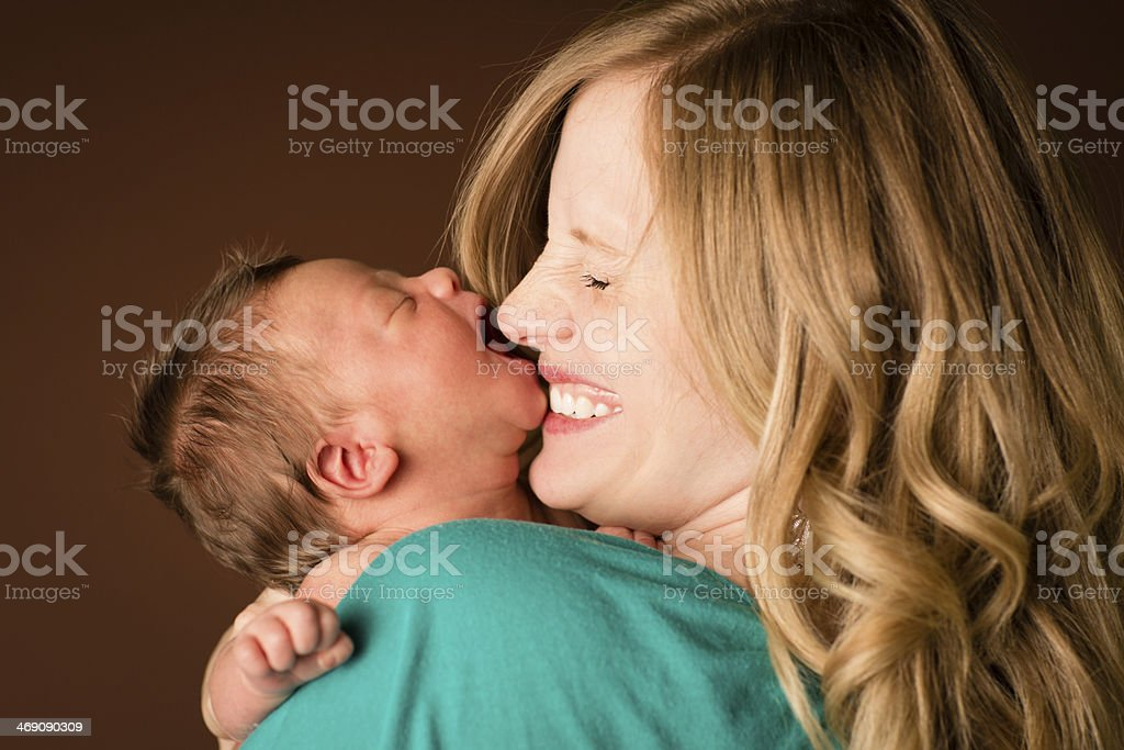 Young Mother Reacts to Newborn Kiss royalty-free stock photo
