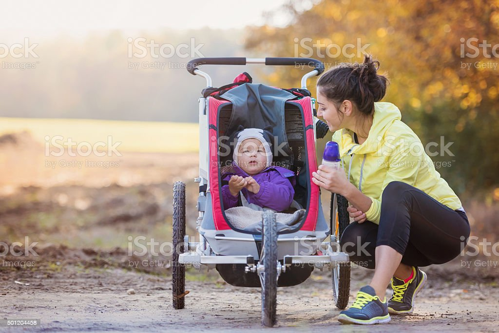 Young mother running stock photo