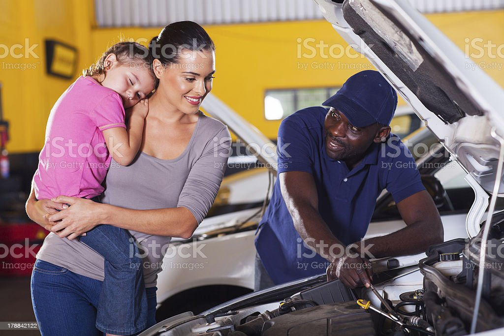young mother taking her car for repair royalty-free stock photo