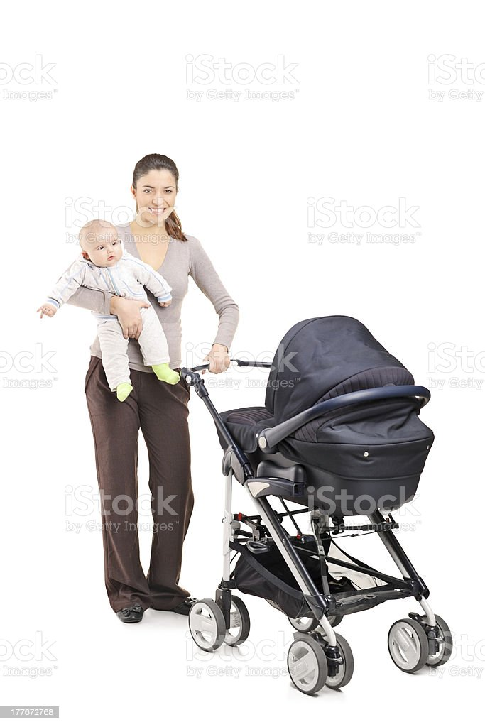 Young mother with a baby and pushchair royalty-free stock photo
