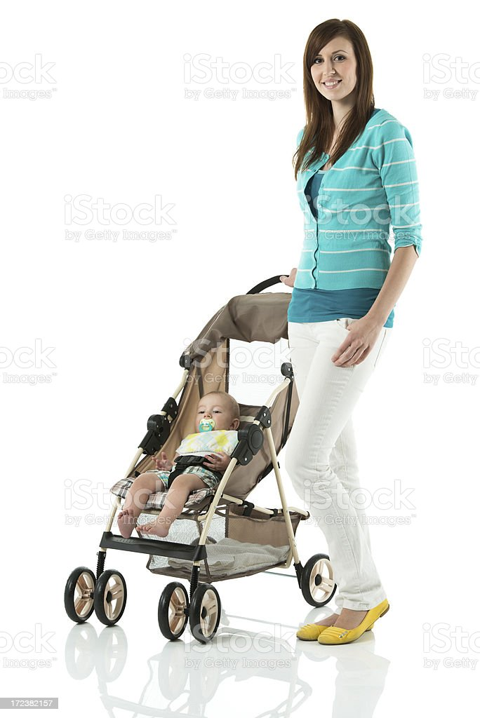 Young mother with baby in perambulator royalty-free stock photo